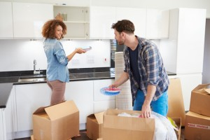 Couple unpacking in new home