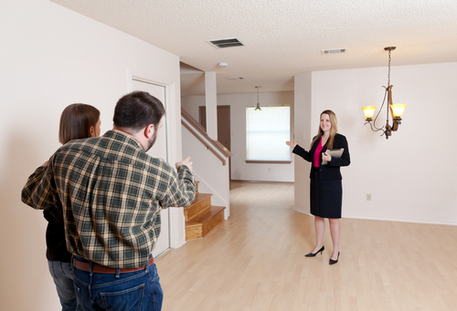 Realtor showing house