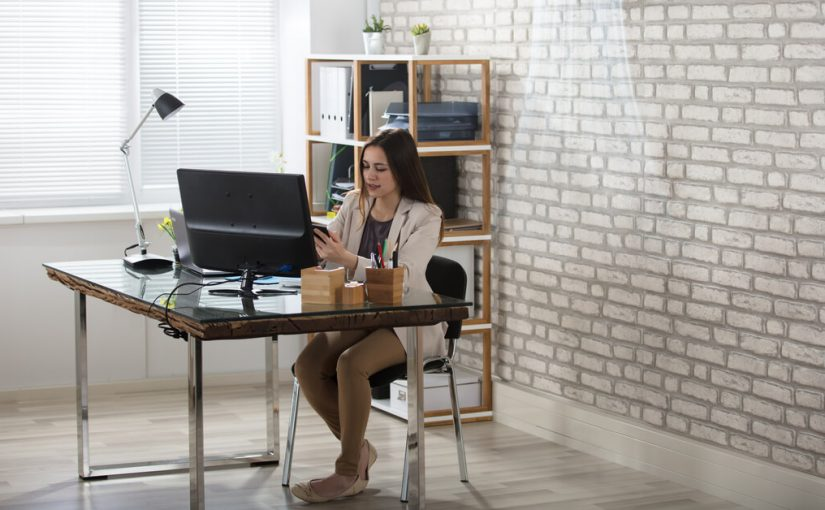 woman working from desk in home office